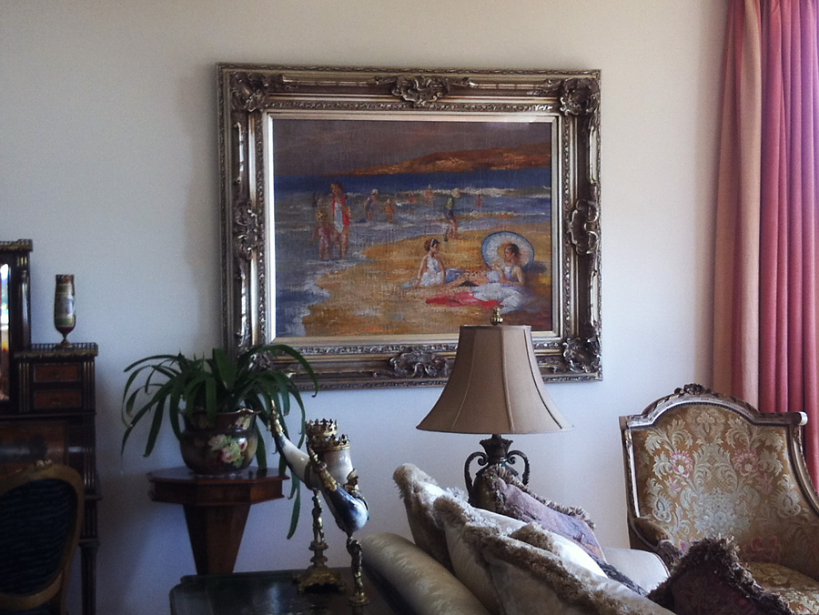 hang large painting, install art in luxury home, hang painting on brick wall