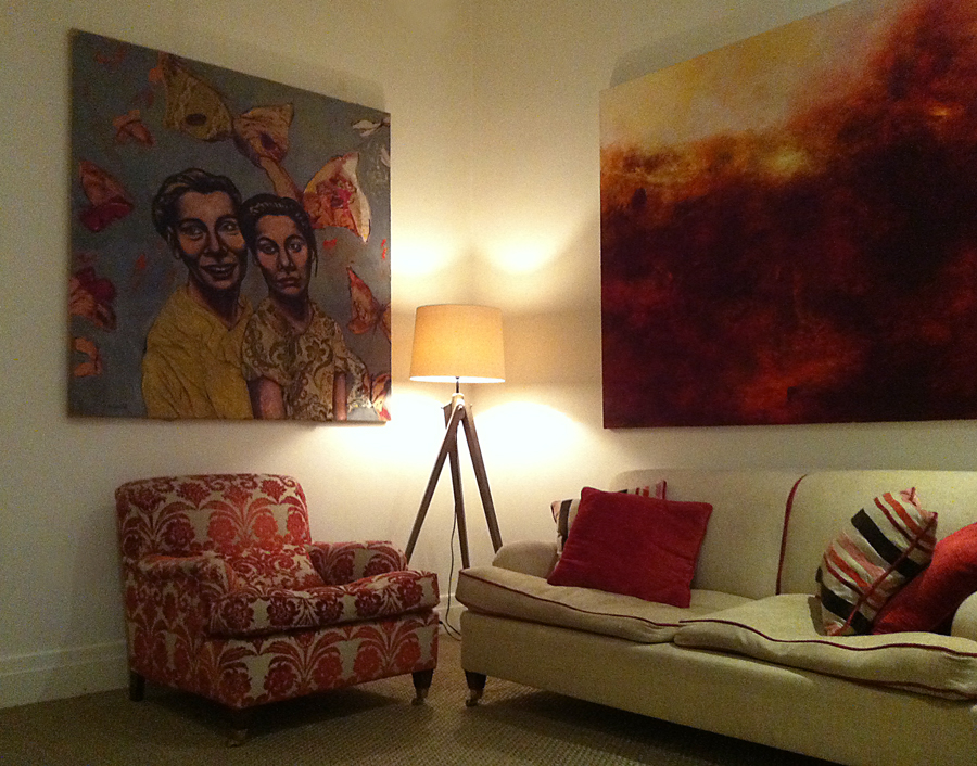 red room decor, hang red paintings, reds create warmth in a room, red canvases, red furniture