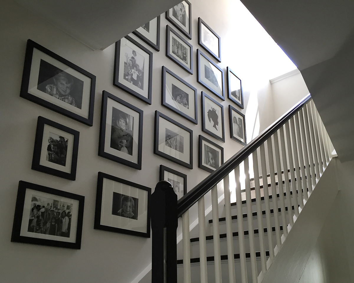 black and white photos, pictures on stairway, stair picture wall